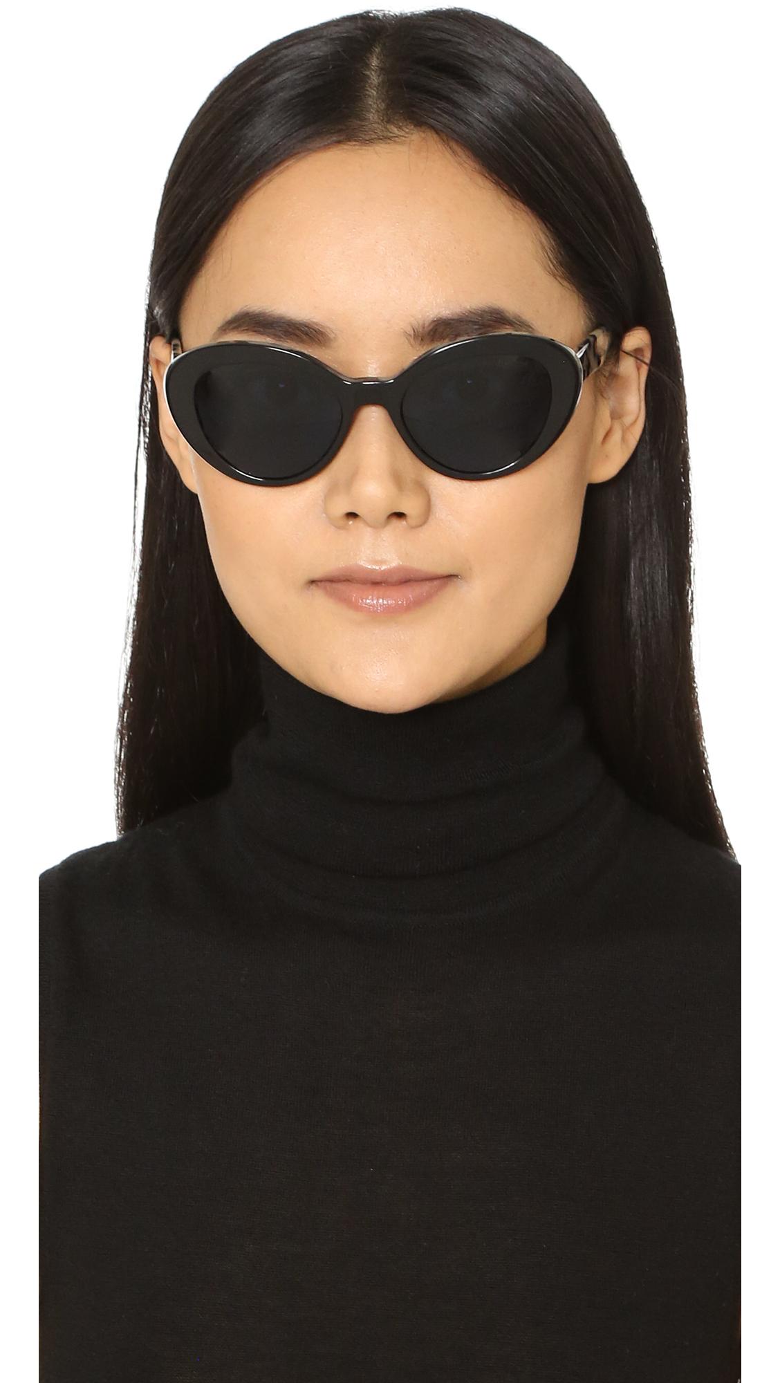 7b8f7d2e47a Lyst - Prada Oval Cat Sunglasses in Black