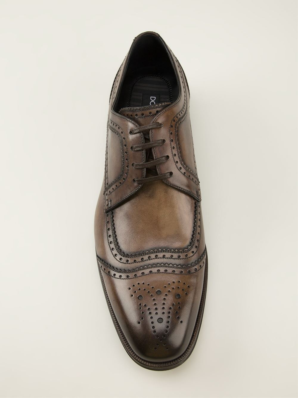 dolce gabbana brogue detailed derby shoes in brown for