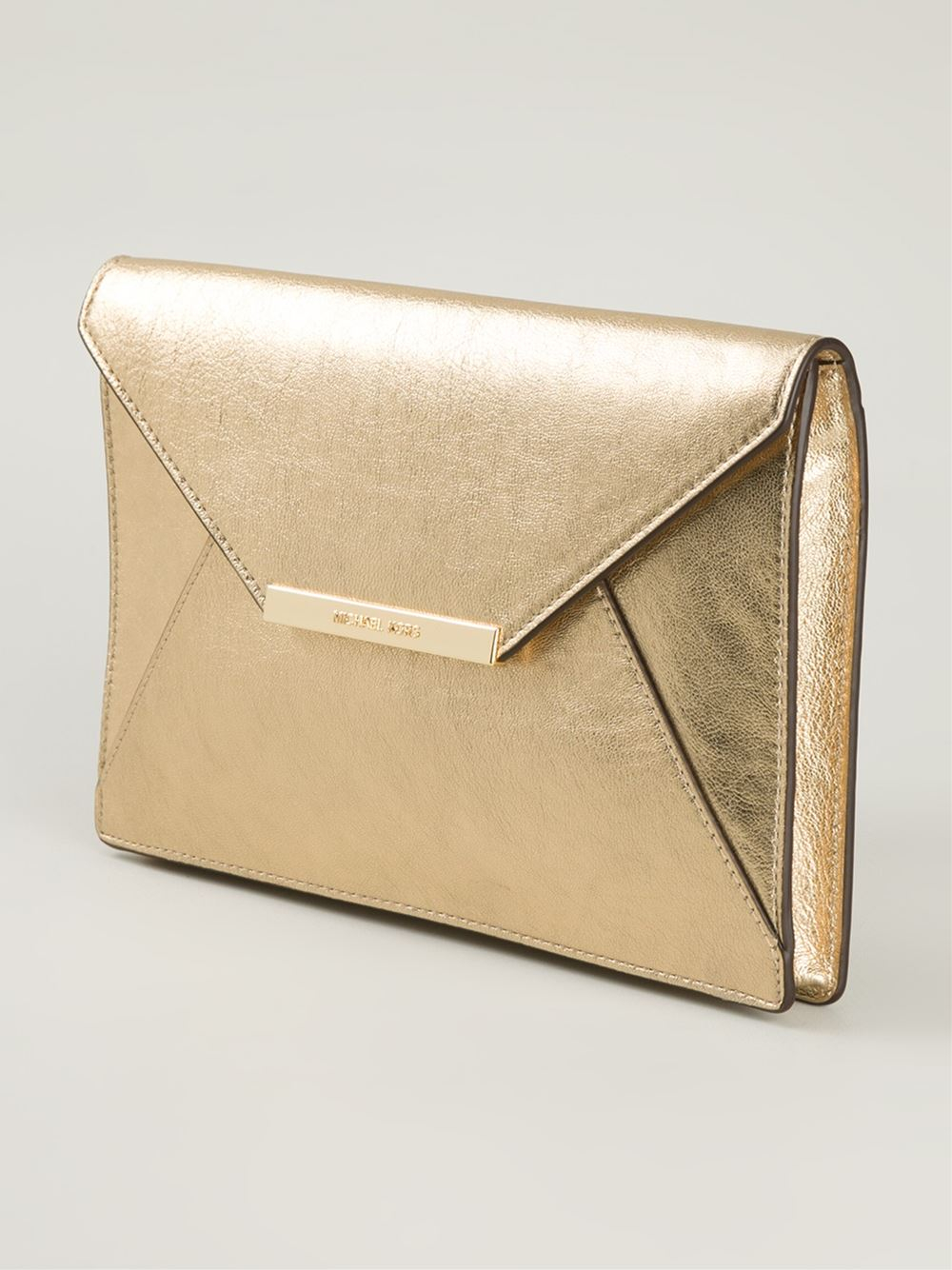 michael michael kors 39 lana 39 envelope clutch in gold metallic lyst. Black Bedroom Furniture Sets. Home Design Ideas