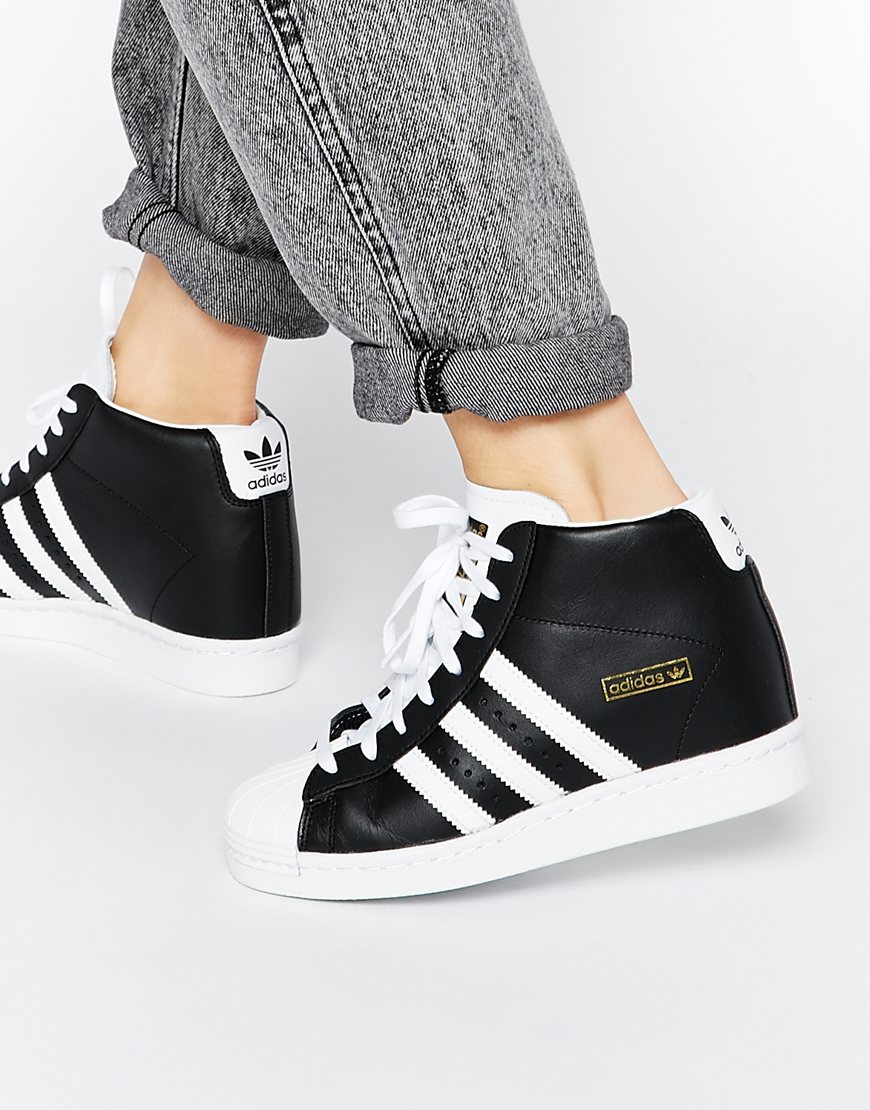 lyst adidas originals superstar concealed wedge black high top sneakers in black. Black Bedroom Furniture Sets. Home Design Ideas