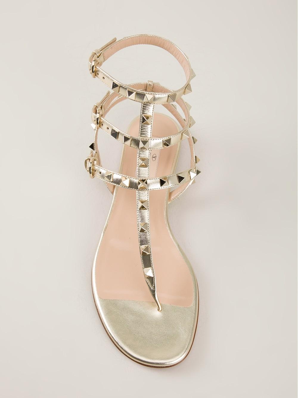 943ae027854 Lyst - Valentino  Rockstud  Thong Sandal in Metallic