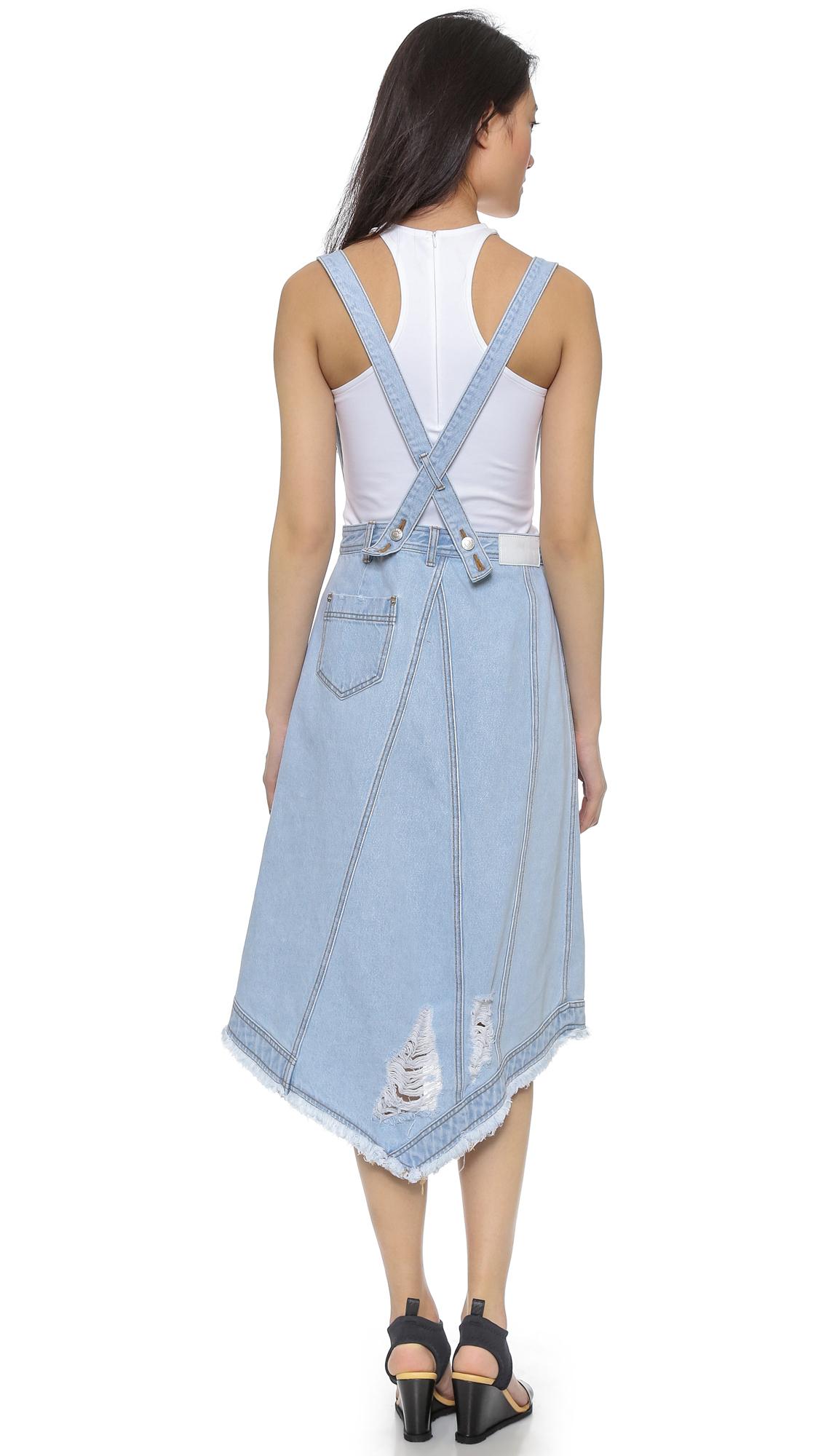 sjyp destroyed denim wrap skirt with suspenders in blue lyst