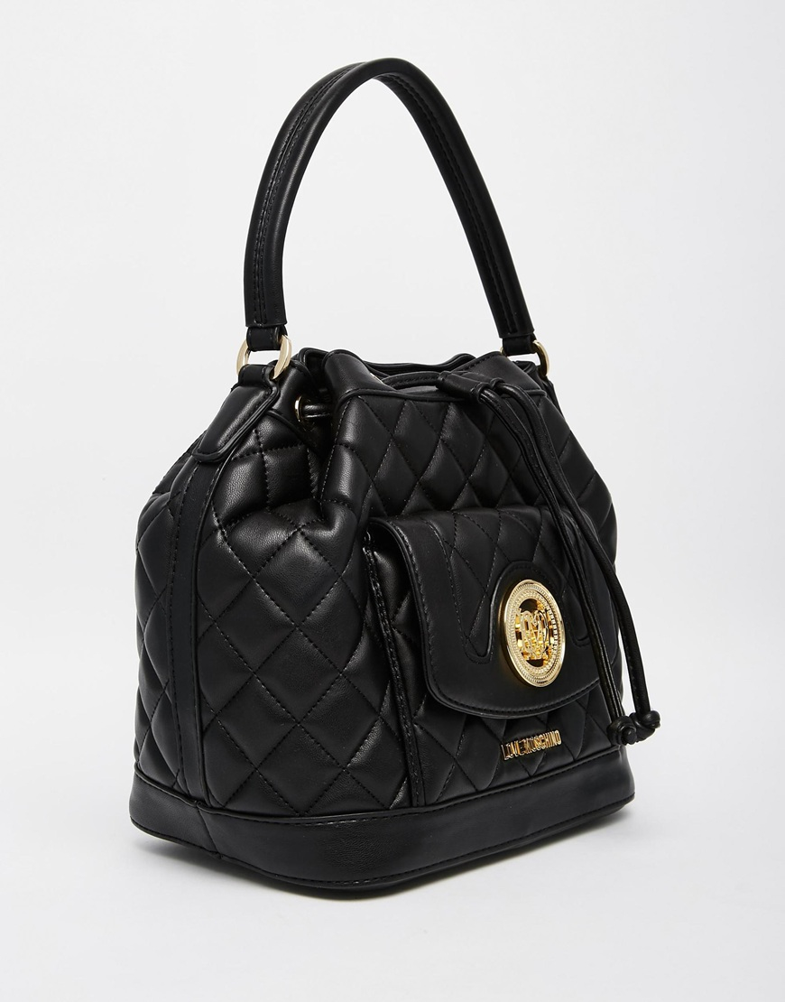 love moschino quilted bucket bag in black in black lyst. Black Bedroom Furniture Sets. Home Design Ideas
