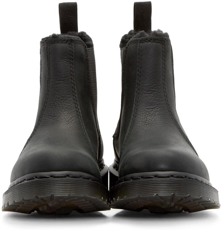 lyst dr martens black fur lined leonore chelsea boots in black. Black Bedroom Furniture Sets. Home Design Ideas
