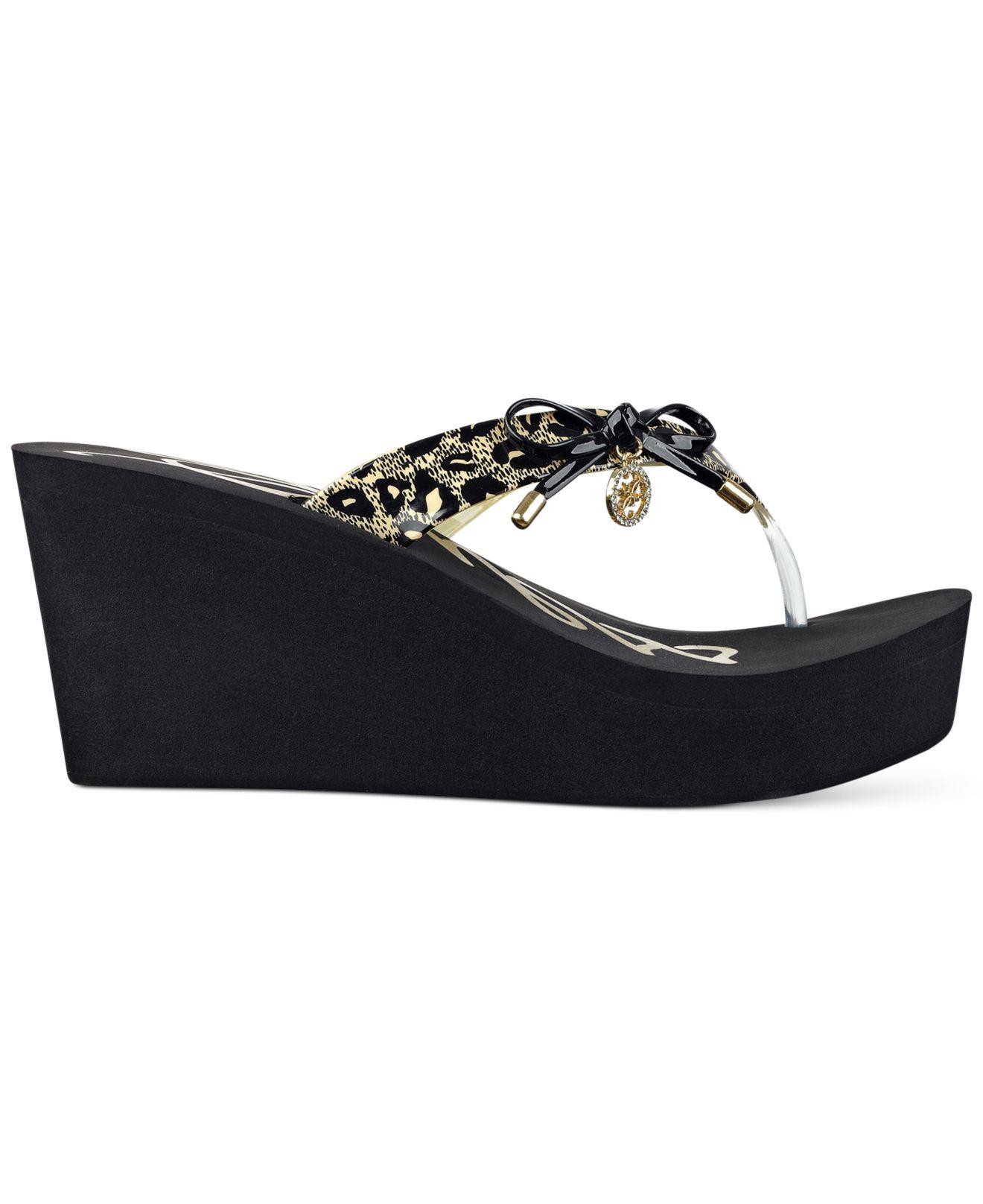 6d766cc9fb77 Lyst - Guess Women s Safire Wedge Flip Flop Sandal in Black