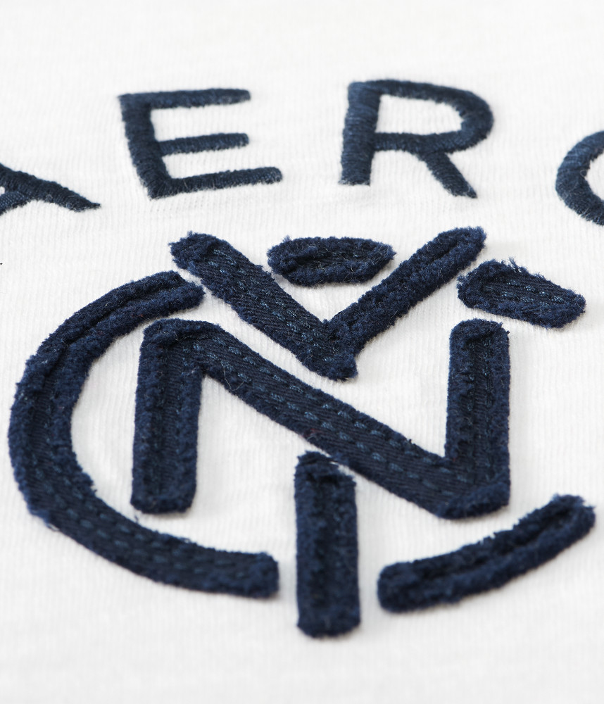 Aeropostal aero nyc linked logo jersey polo in white for for Can you bleach white shirts with logos