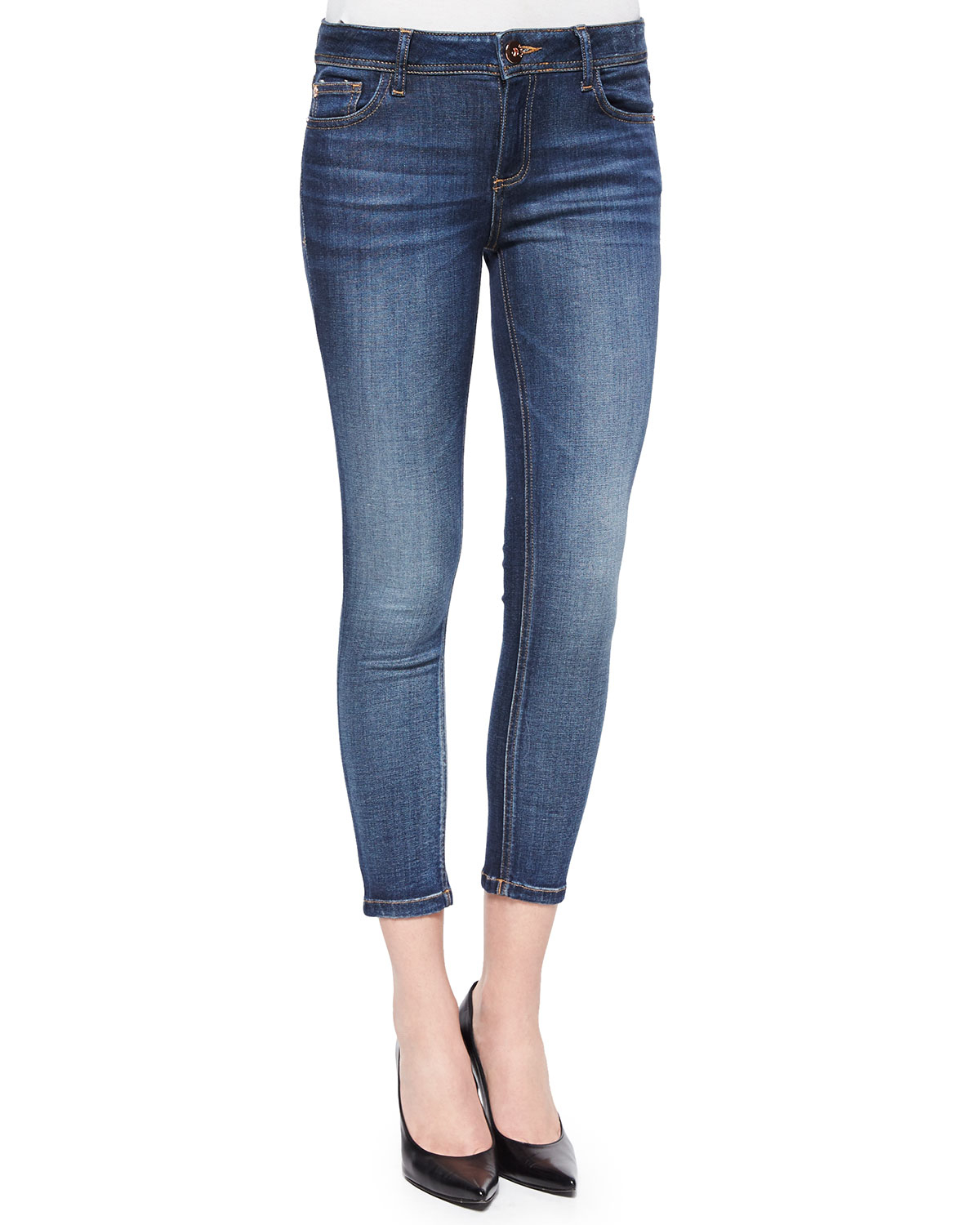 Crafted with stretch for the most comfortable fit, these cropped skinny charcoal jeans from 7 for all Mankind are a flattering choice. Distressed trims and scattered detail on the ankles keep the look current and contemporary.