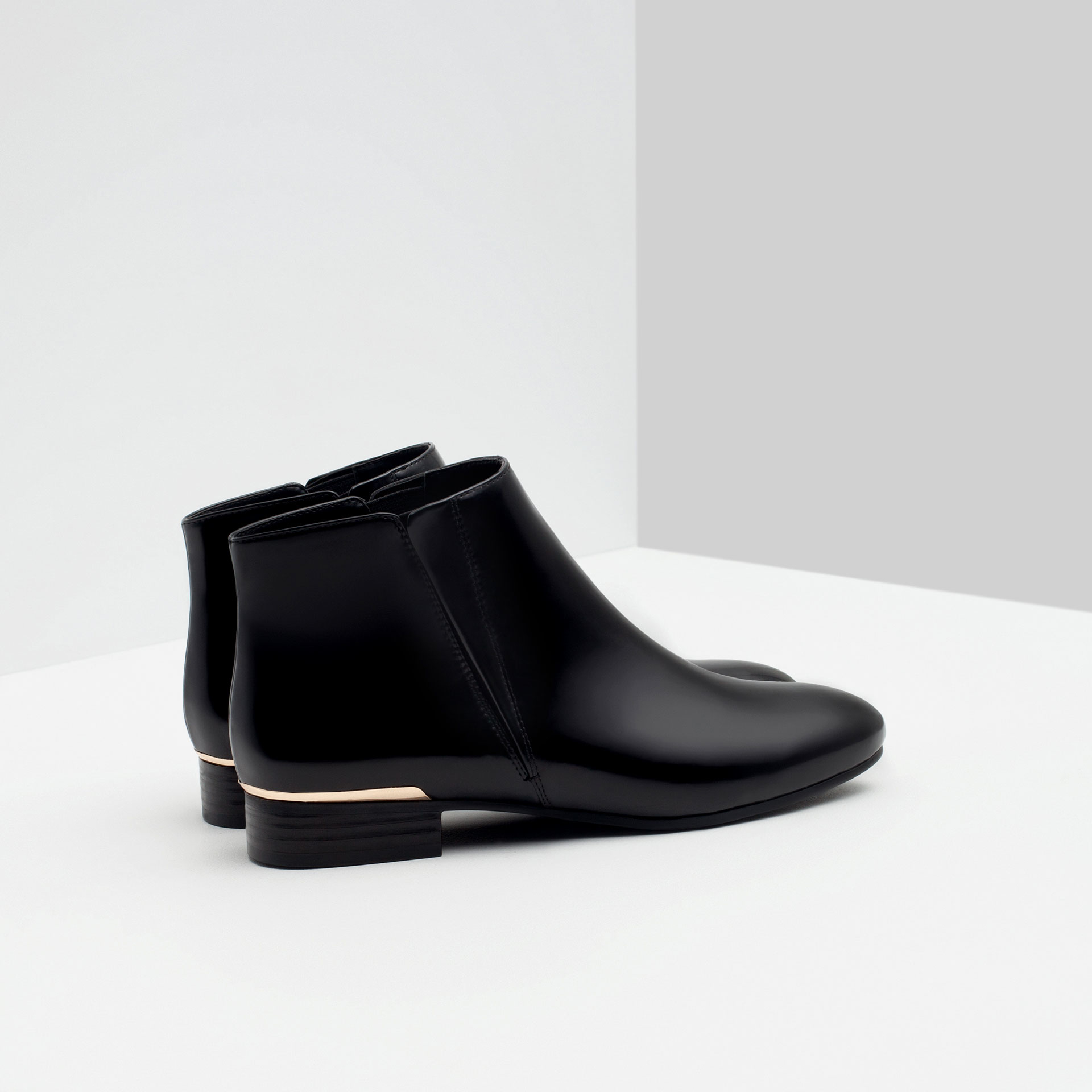 zara flat ankle boots with metal detail in black lyst