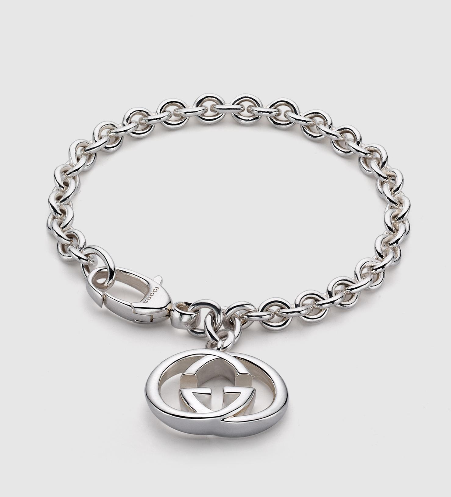 gucci bracelet with interlocking g motif charm in metallic
