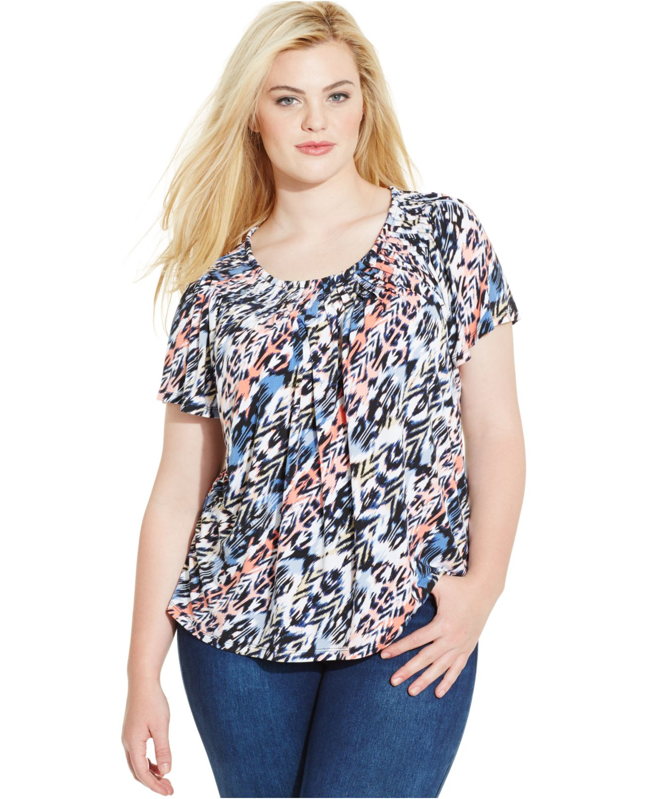 Product Description bib adds chic sparkle to the classic and gauzy plus size peasant top.