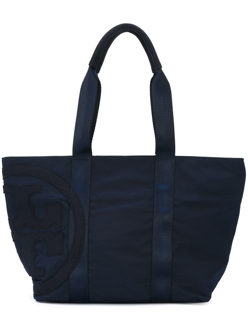 burch canvas tote bag in blue lyst