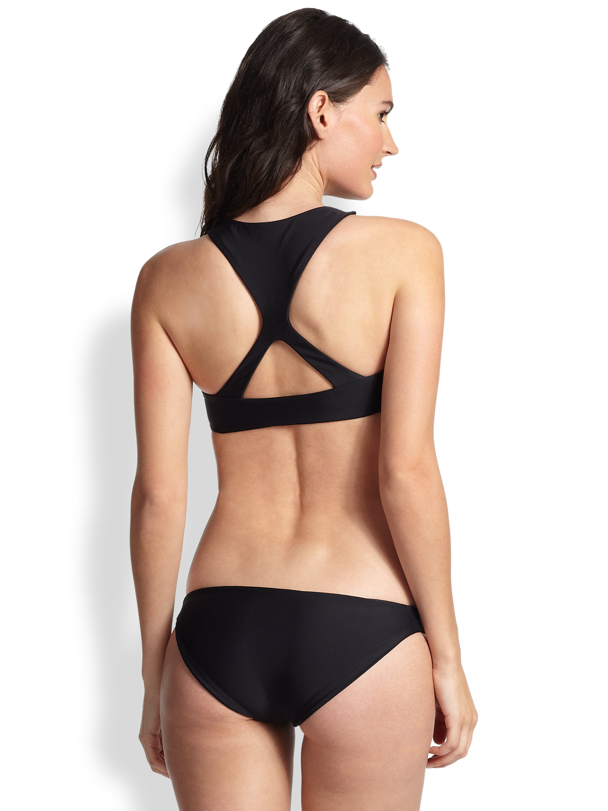 The Joan Smalls Cut-Out Racerback Bikini Top is a sporty silhouette. It's built up triangle cups and removable pads will keep you stylish and supported. The best part is the back, featuring an open keyhole racerback with a trendy tie closure.