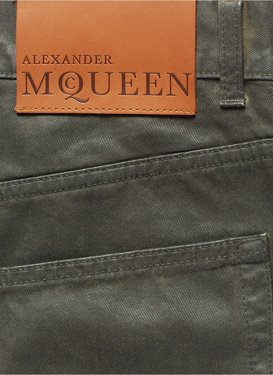 lyst alexander mcqueen leather tag coated jeans in green for men