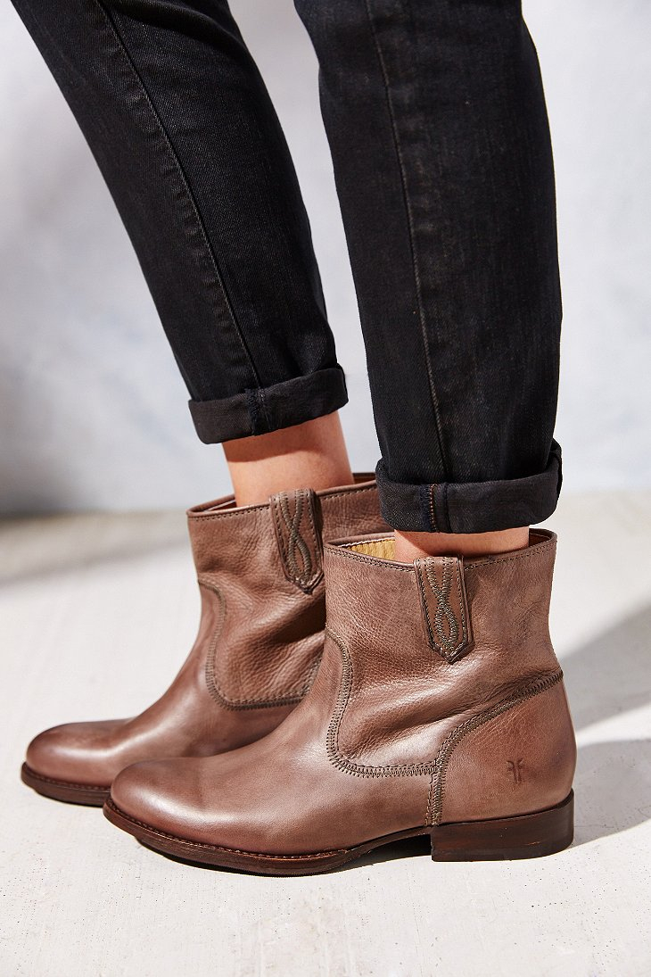 Guide to styling short and tall boots. Why this works: Since booties end at the ankle, they can cut off your leg line in an awkward way. Ease the transition with like-colored legwear. Black.