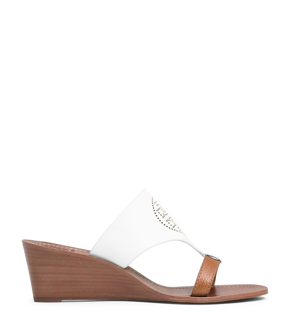 e75a6a05d Lyst - Tory Burch Perforated Logo Wedge in White