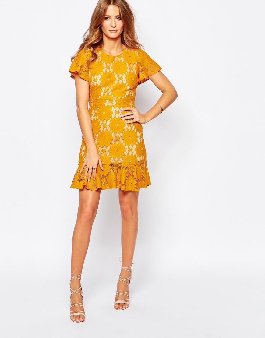 Lace Pep Hem Dress In Mustard