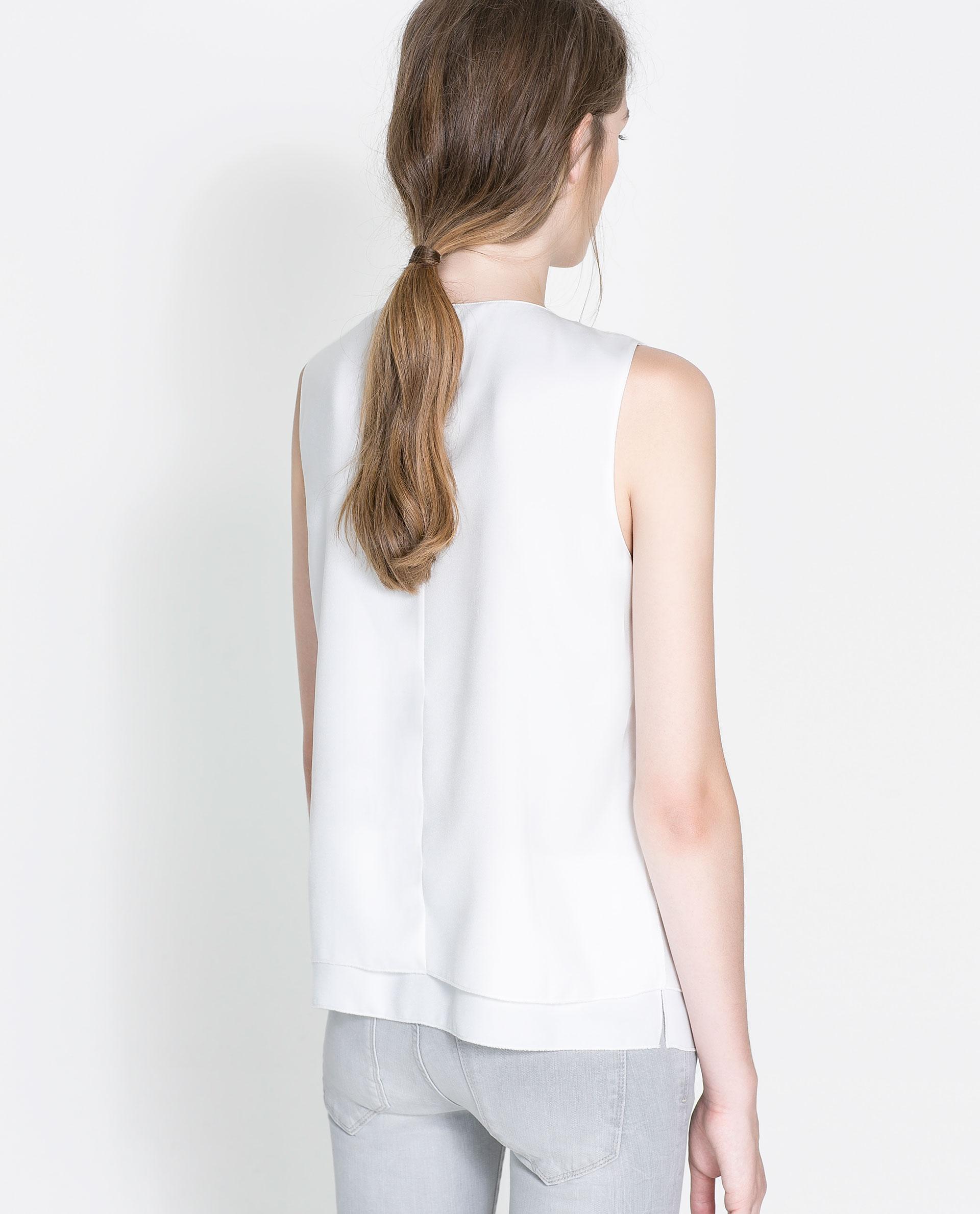 Sleeveless White Blouse Long 95