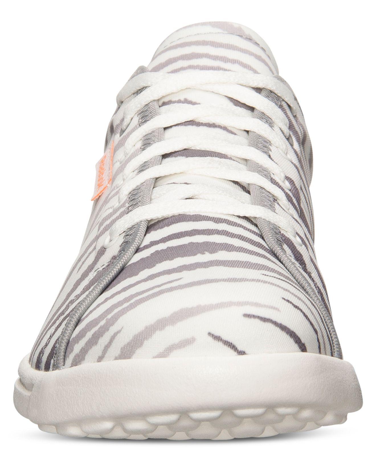 c56845405f0 Lyst - Reebok Women S Skyscape Runaround Print Walking Sneakers From ...