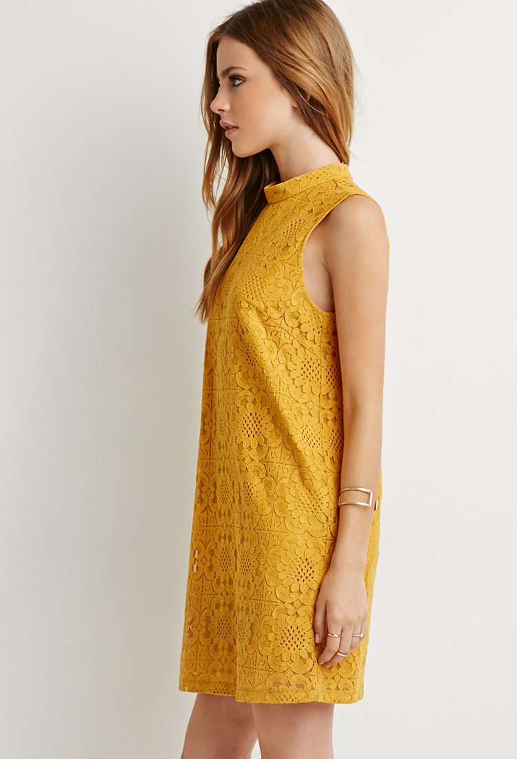 Yellow dress with black lace overlay