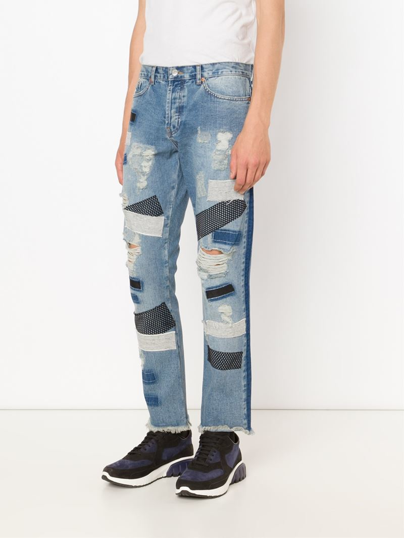 James long Distressed Patched Jeans in Blue for Men | Lyst