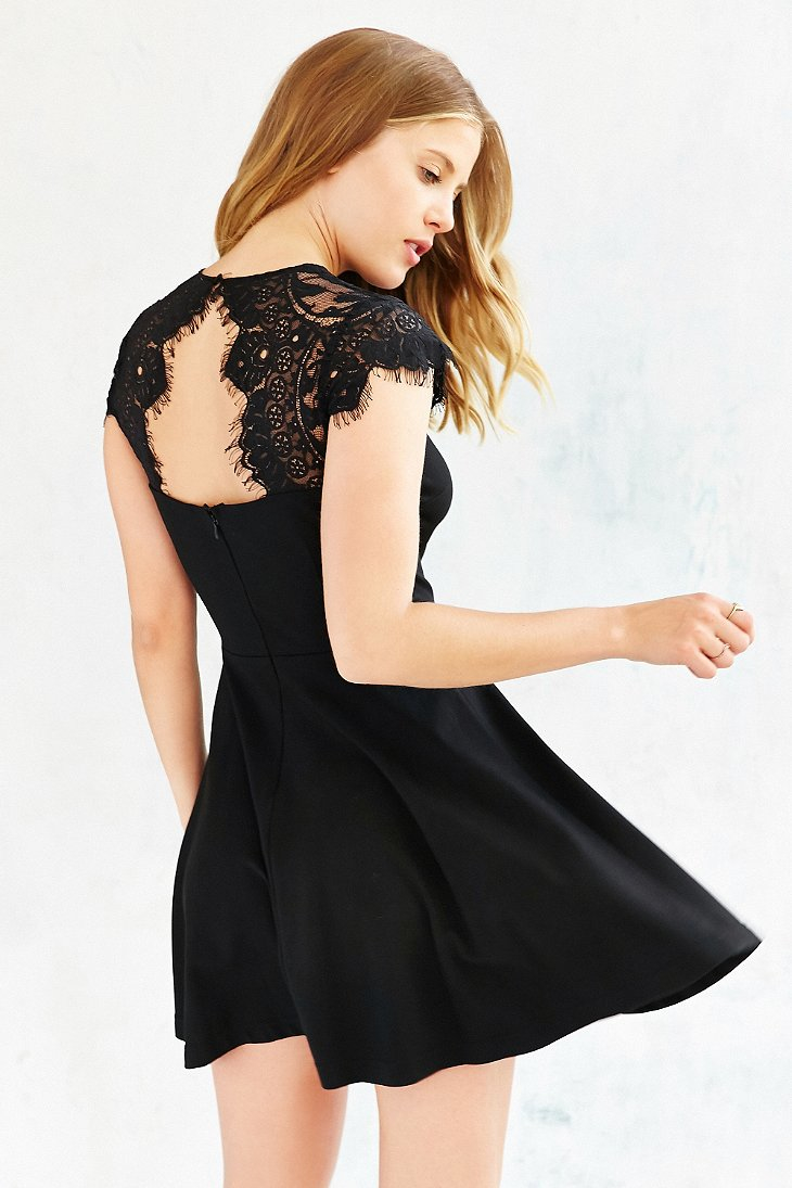 Fit and flare black dress with bow