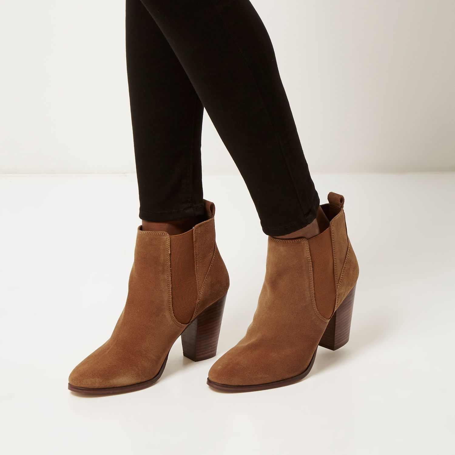 Suede Ankle Boots. Both men and women can enjoy the hip, fun style of suede ankle boots. Out of all the men's shoes in the world, this style of footwear add some variation to the average wardrobe. For men who already have tons of hard leather boots, a pair of soft suede boots can be a welcome change.