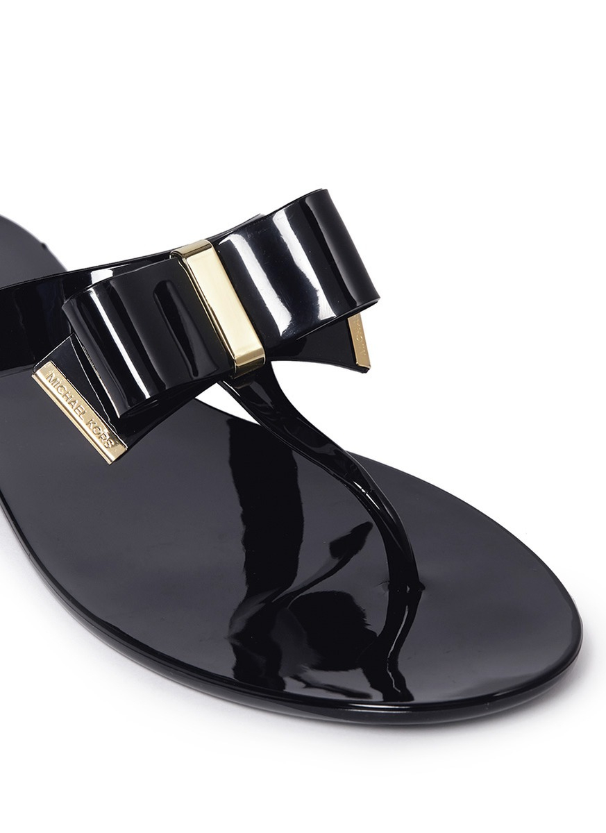 ce2ba998fba4 Lyst - Michael Kors Kayden Bow Thong Sandals in Black