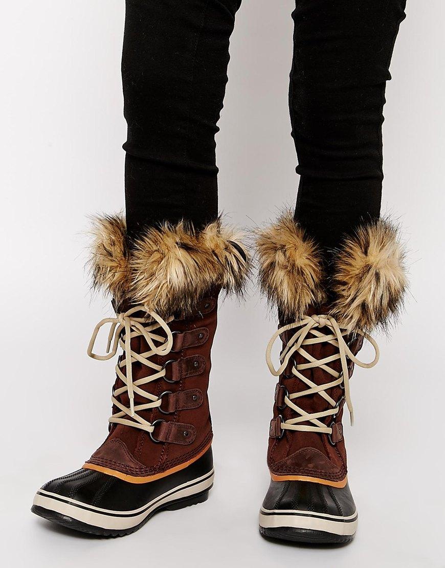 lyst sorel joan of arctic tobacco brown faux fur cuff. Black Bedroom Furniture Sets. Home Design Ideas