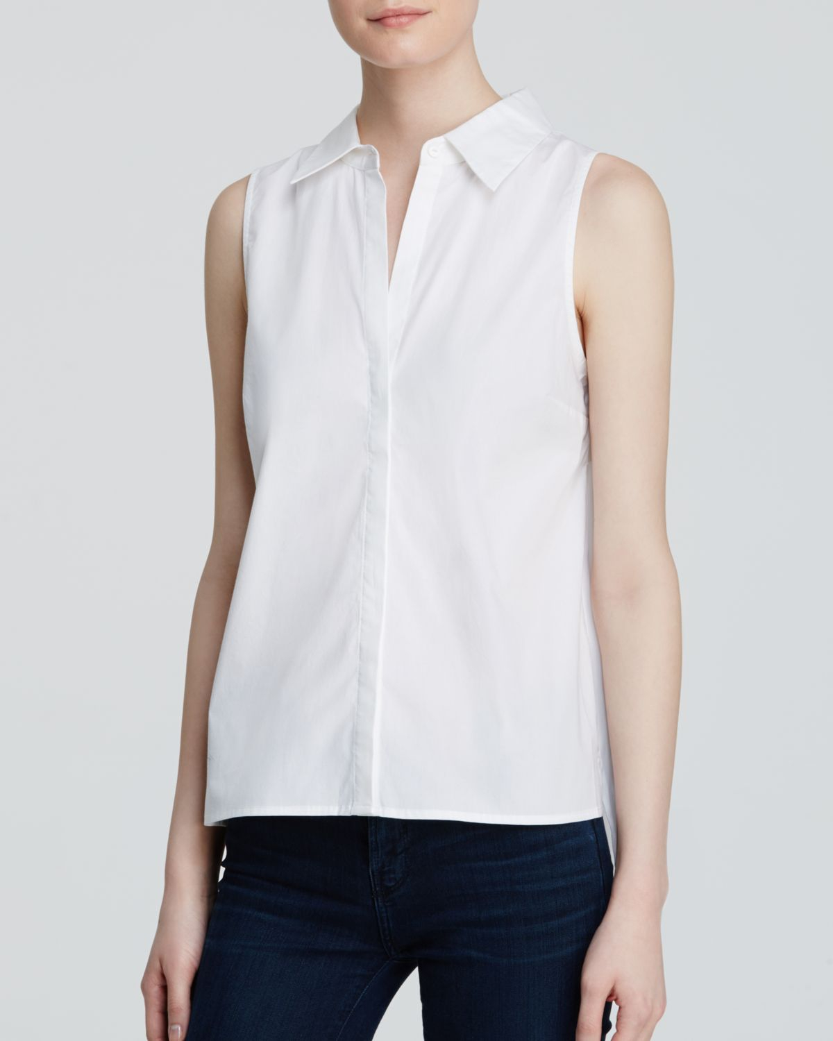 Sleeveless Poplin Shirt: Best-selling style with a touch of stretch for a great fit. Button front and bust darts waist seams for shaping. Button front and bust darts waist seams for shaping. Cotton/spandex.