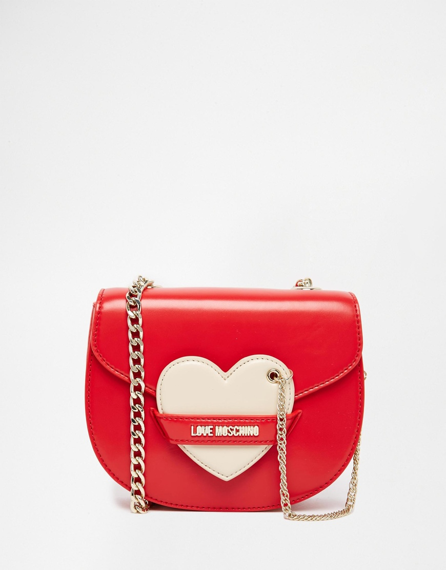 love moschino saddle bag with heart detail in red lyst. Black Bedroom Furniture Sets. Home Design Ideas