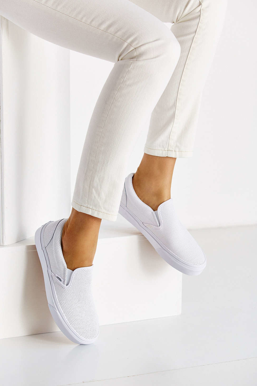 b1359bd1779333 Lyst - Vans Perforated Leather Slip-on Sneaker in White