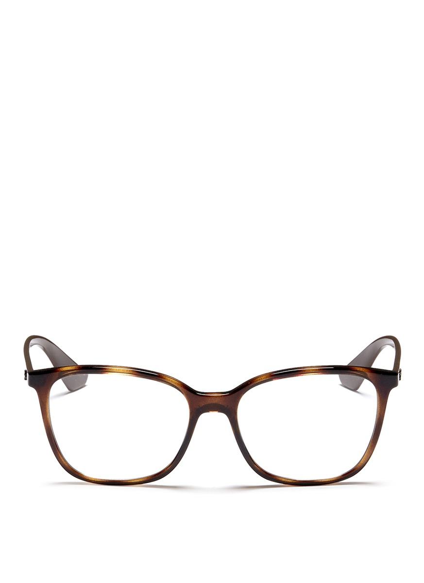 e38df00dda Lyst - Ray-Ban  rb7066  Tortoiseshell Effect Acetate Optical Glasses ...