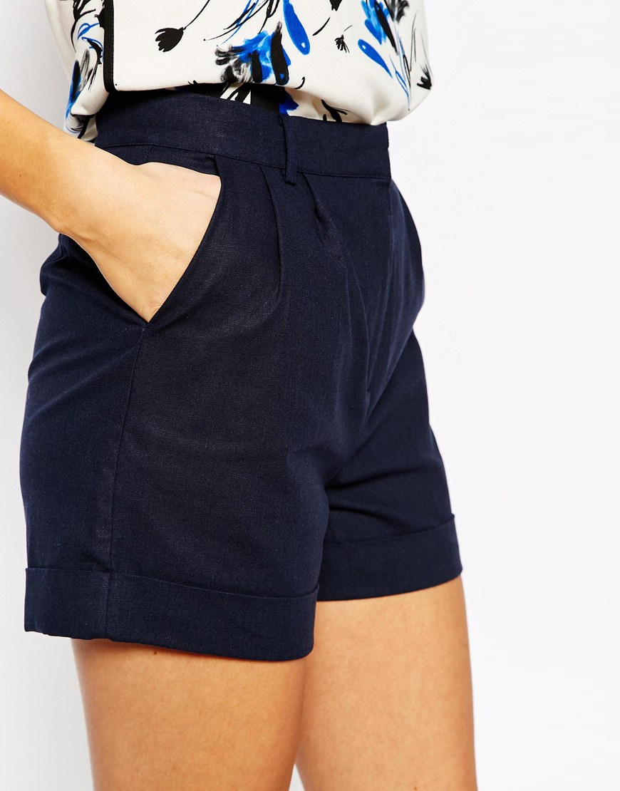 Sleek, woven cotton-blend shorts have a touch of stretch, a high waist, and flirty cut. Diagonal front pockets, and decorative back welted pockets. Hidden side zipper/clasp/5(11).