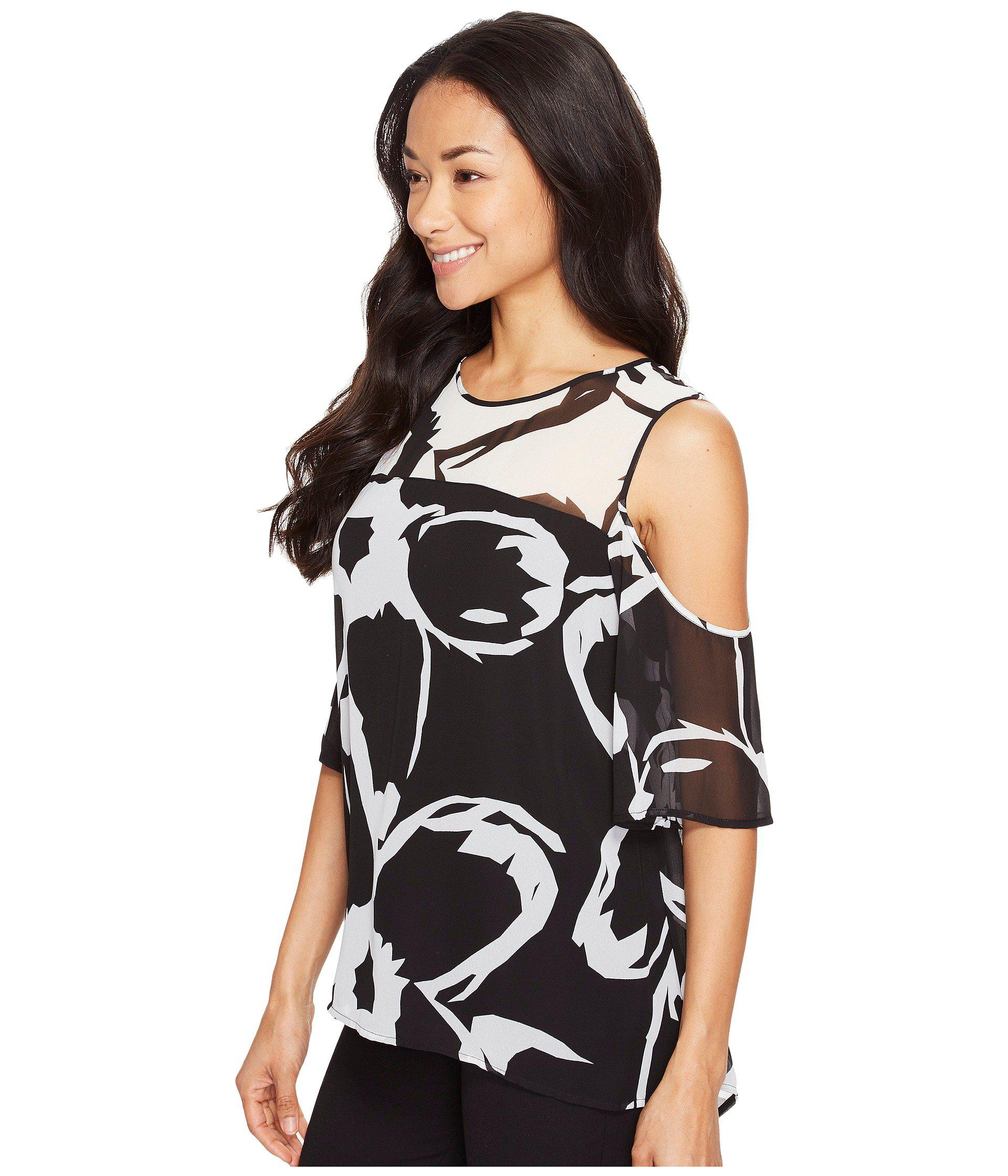 03fb80c7f2a81 Lyst - Vince Camuto Short Sleeve Cut Out Floral Cold-shoulder Blouse in  Black - Save 36%