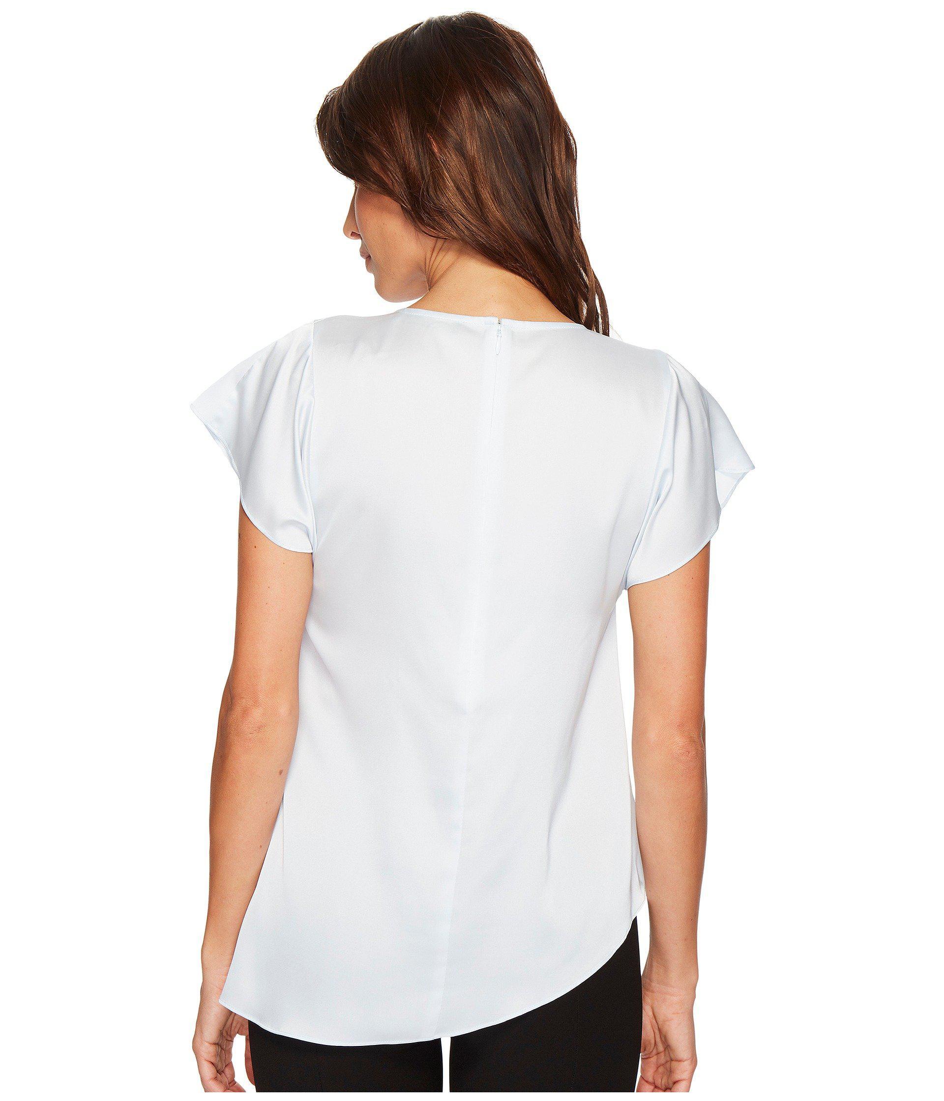 20b24cf988c81 Ivanka Trump - White Ruffle Cap Sleeve Woven Asymmetrical Hem Blouse -  Lyst. View fullscreen