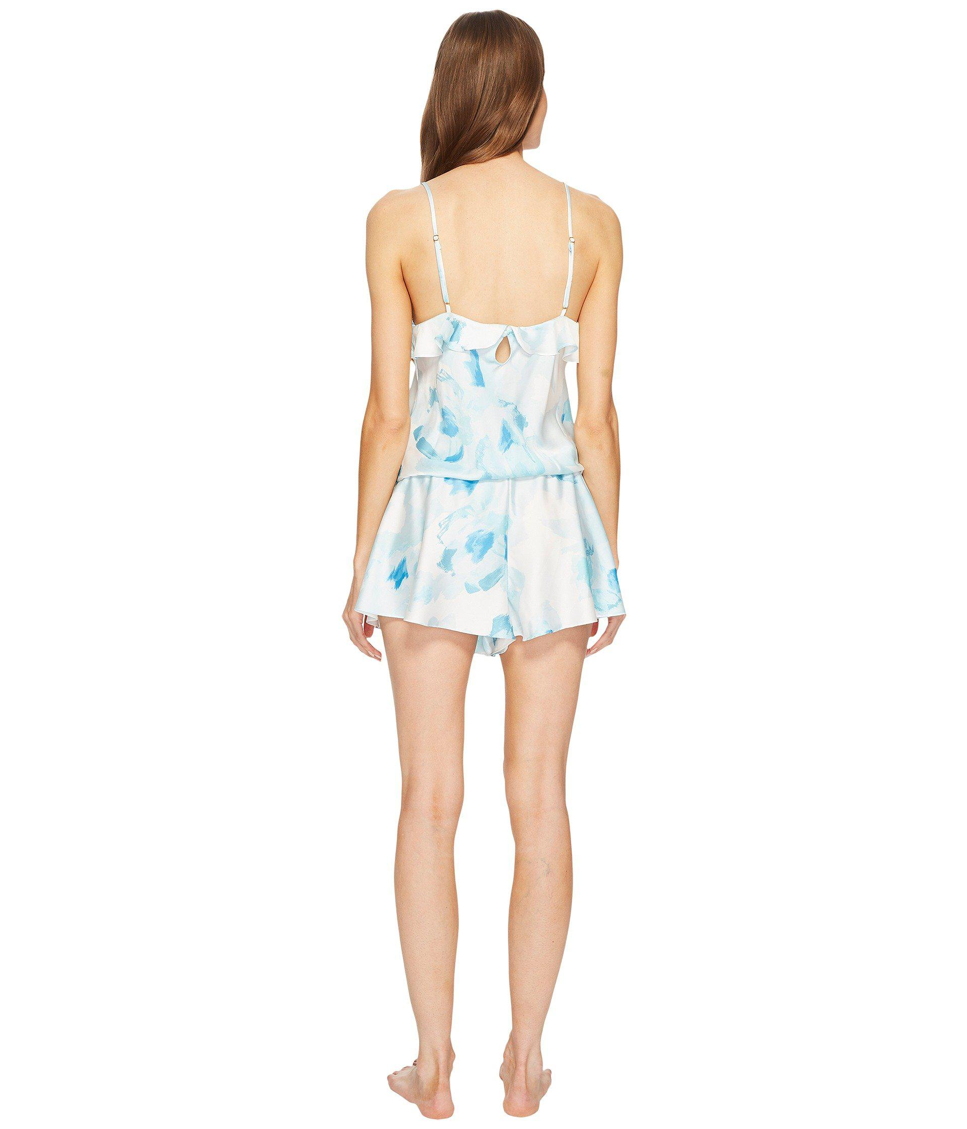 c151ae5ba42f Lyst - Kate Spade Moroccan Rose Satin Romper in Blue - Save 65%