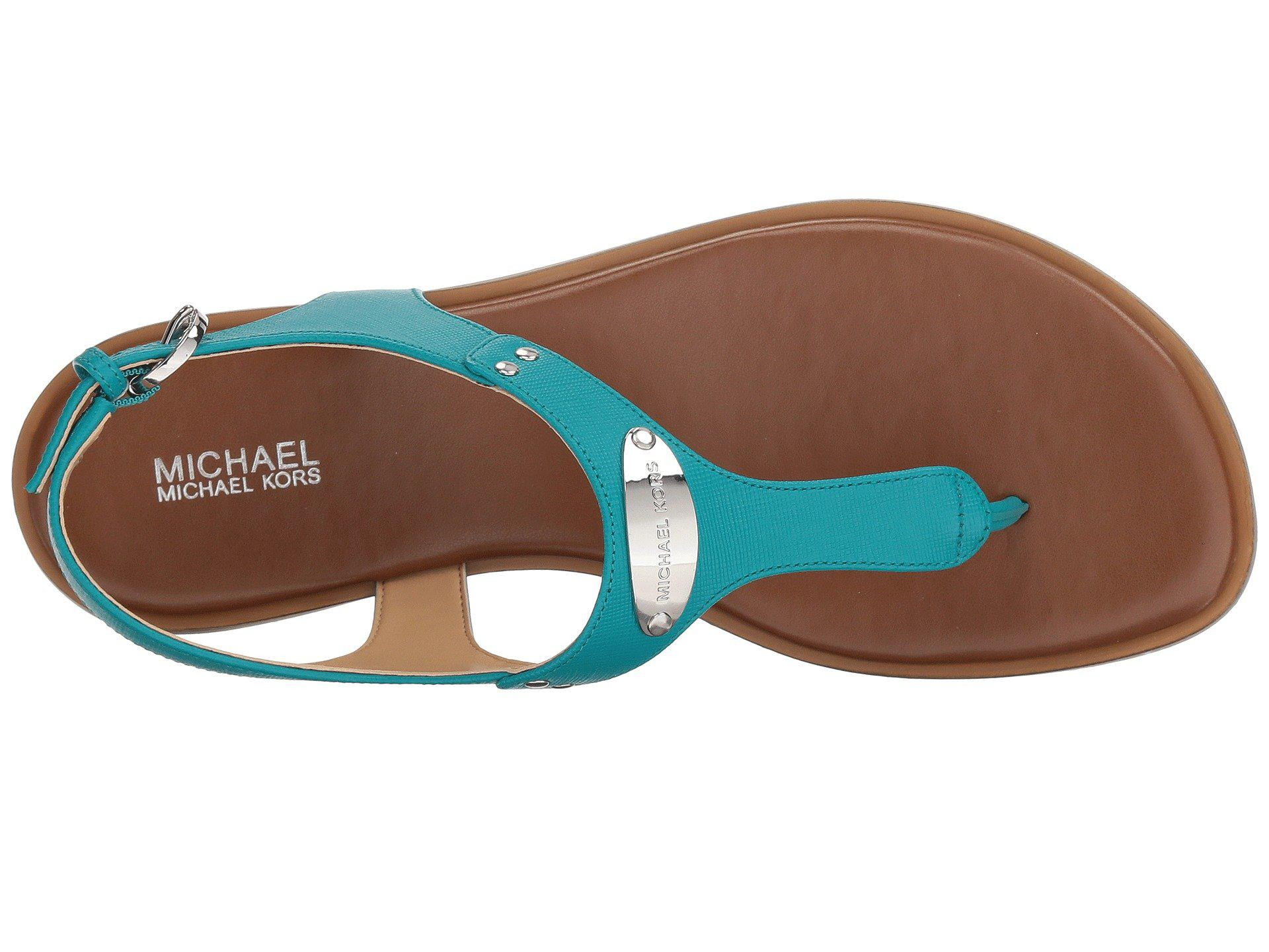 f479963eec587a Lyst - MICHAEL Michael Kors Mk Plate Thong in Blue - Save 9%