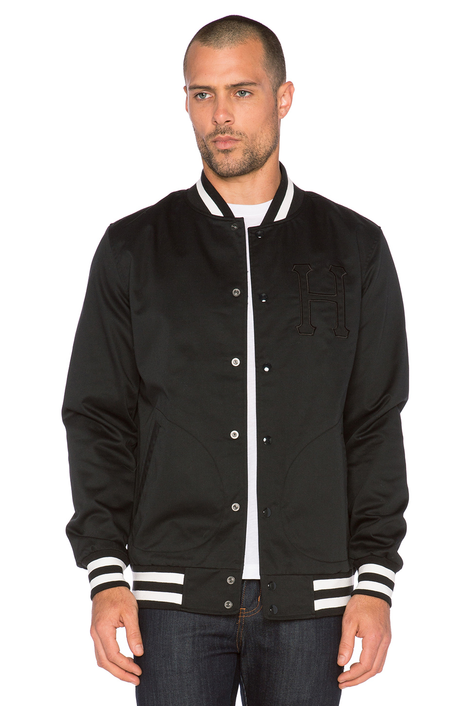 Custom Letterman Jackets For Men Custom letterman jackets for men made of Top Quality Wool Navy Blue and Genuine Leather Sleeves in top grain white. We used the high quality acrylic ribbing bottom, collar and cuffs for this custom Letterman Jackets for men.