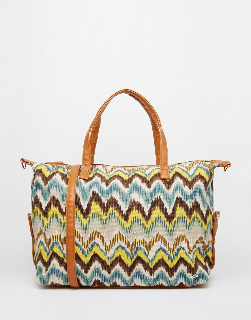 Carpisa Canvas Printed Travel Bag | Lyst