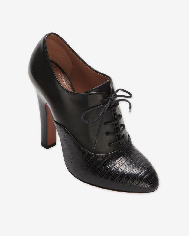 ae3c9d4c16ec Alaïa Lace Up Oxford Booties Black in Black - Lyst