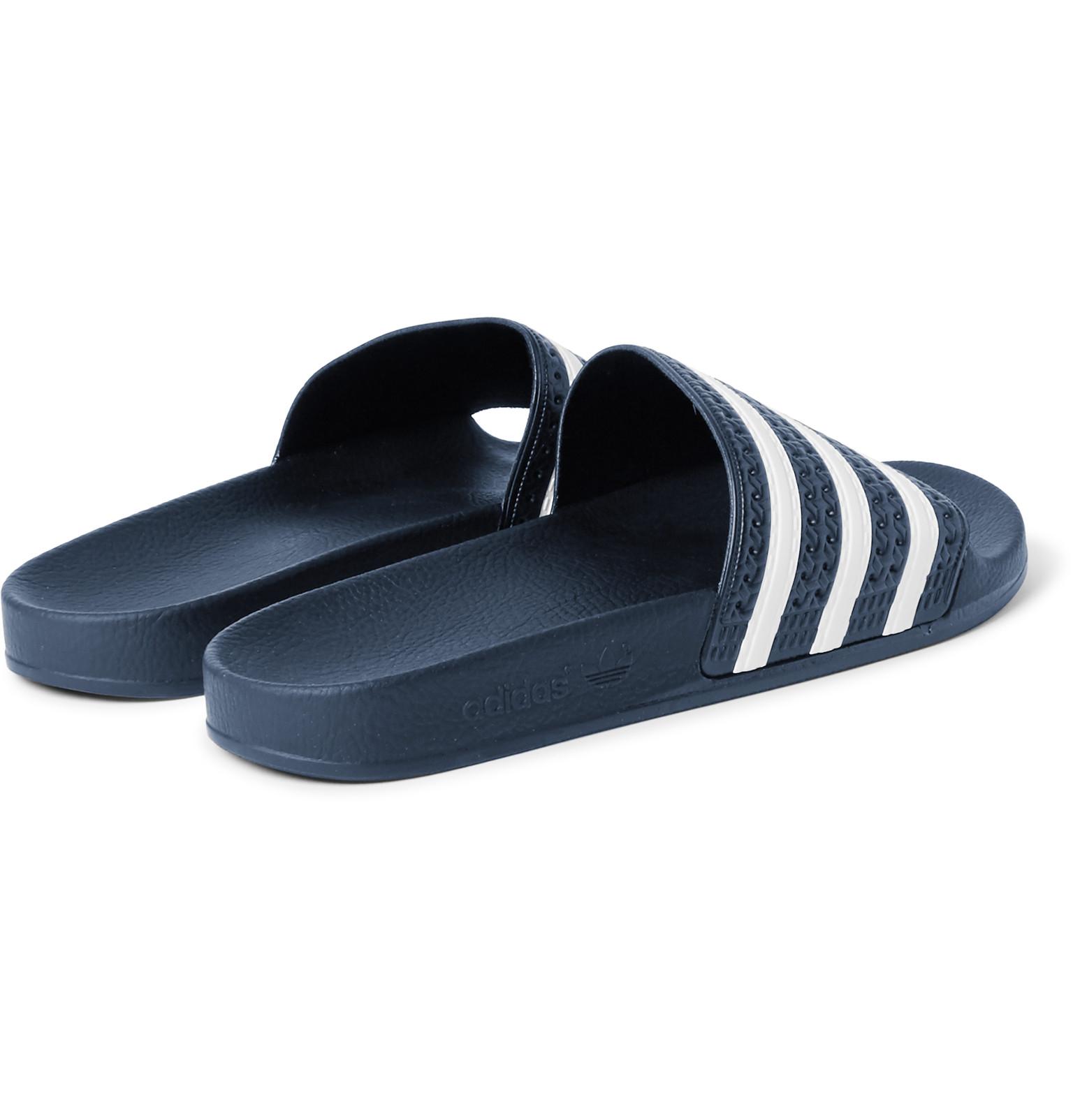 d261ead41c9 adidas Originals Adilette Textured-rubber Slides in Black for Men - Lyst