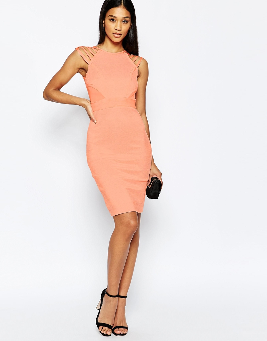 Wow couture bandage dress with strap details in pink lyst for Couture garments