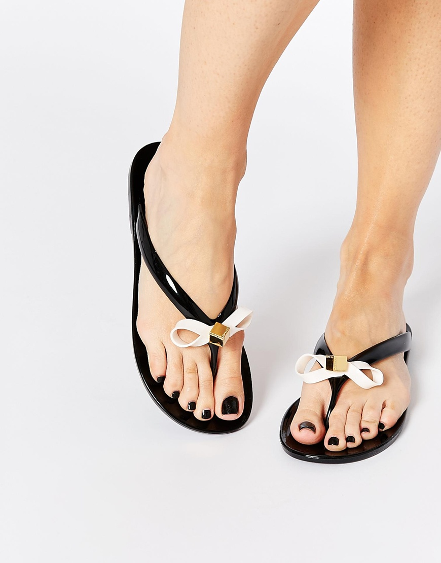 cba90f92c038bc Lyst - Ted Baker Taito Black Jelly Bow Flip Flops in Black