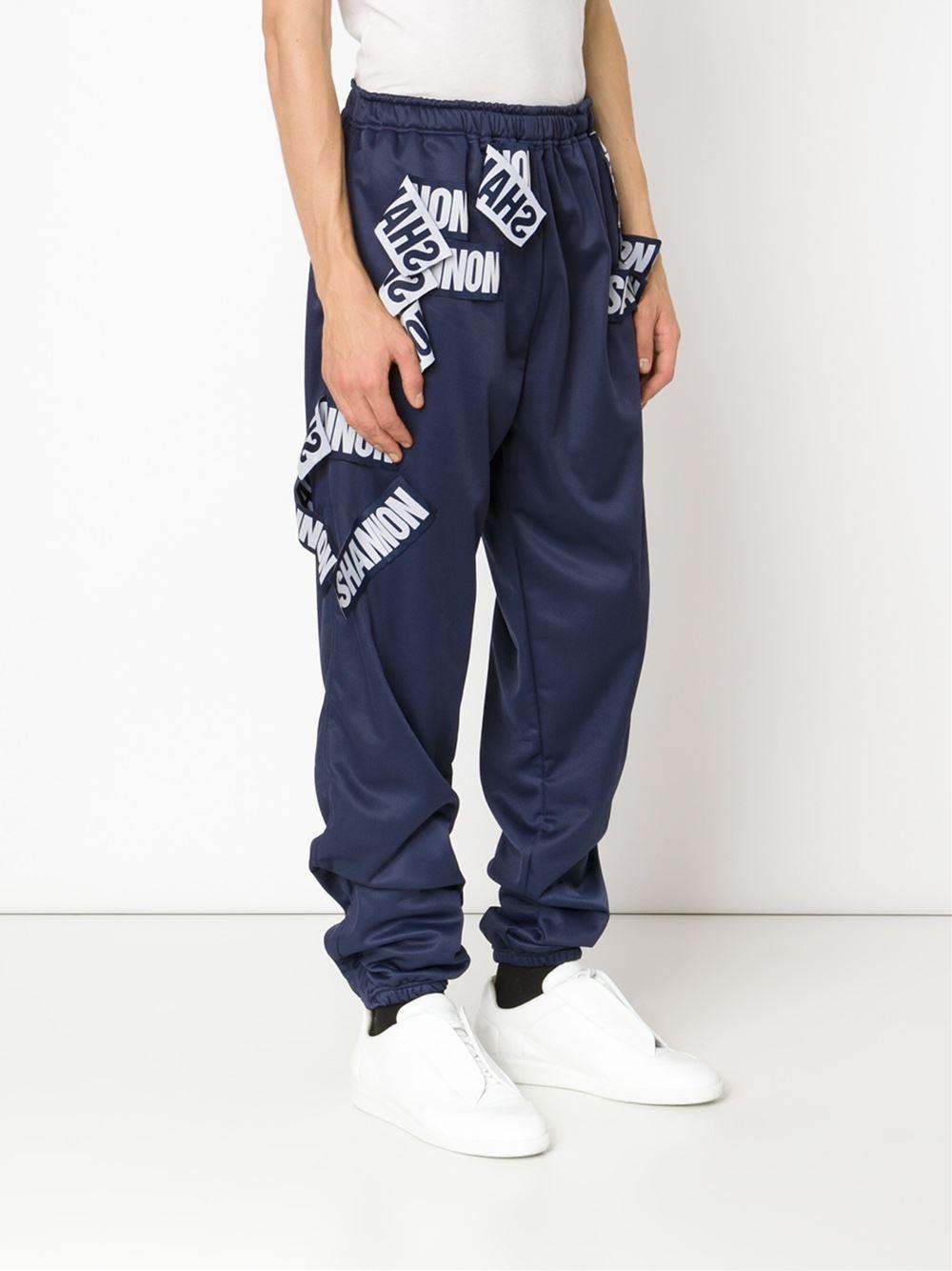 Christopher Shannon Patch Appliqué Trousers in Blue for Men