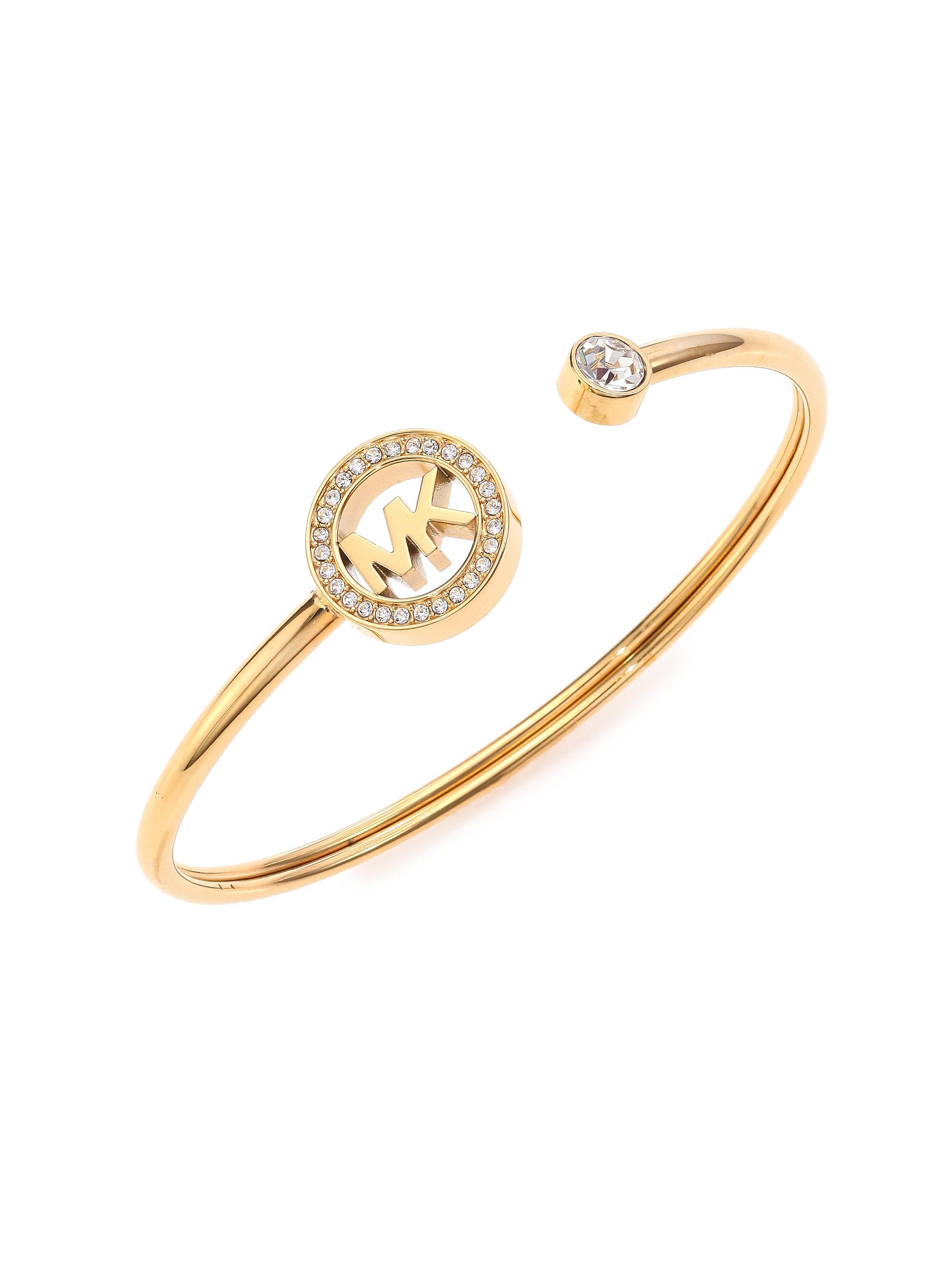 lyst michael kors fulton logo cuff bracelet goldtone in. Black Bedroom Furniture Sets. Home Design Ideas