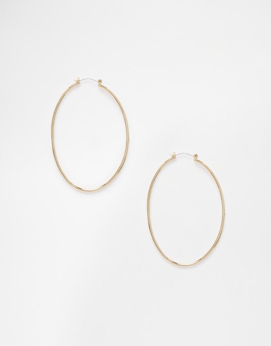 cheap monday eclipse hoop earrings in metallic lyst