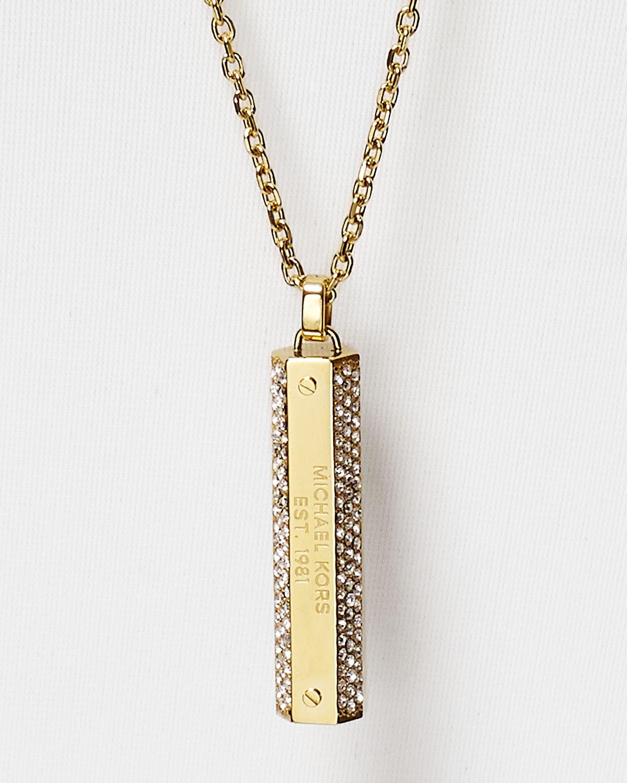 cc9dcf04b909 Lyst - Michael Kors Pavé Logo Plaque Pendant Necklace