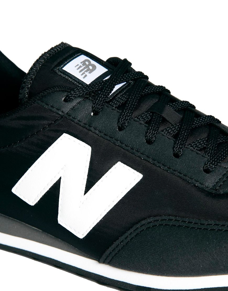 new balance burgundy/black 410 trainers