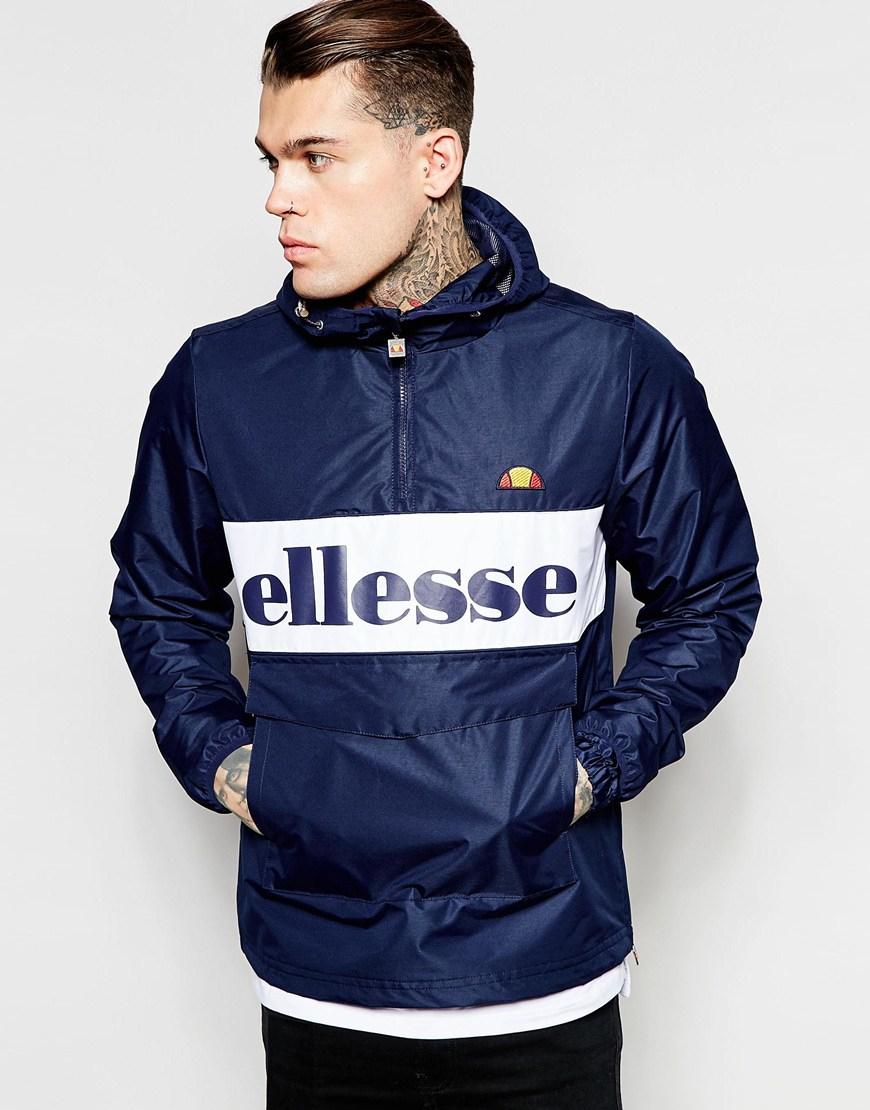 ellesse overhead jacket with large logo in blue for men navy lyst. Black Bedroom Furniture Sets. Home Design Ideas