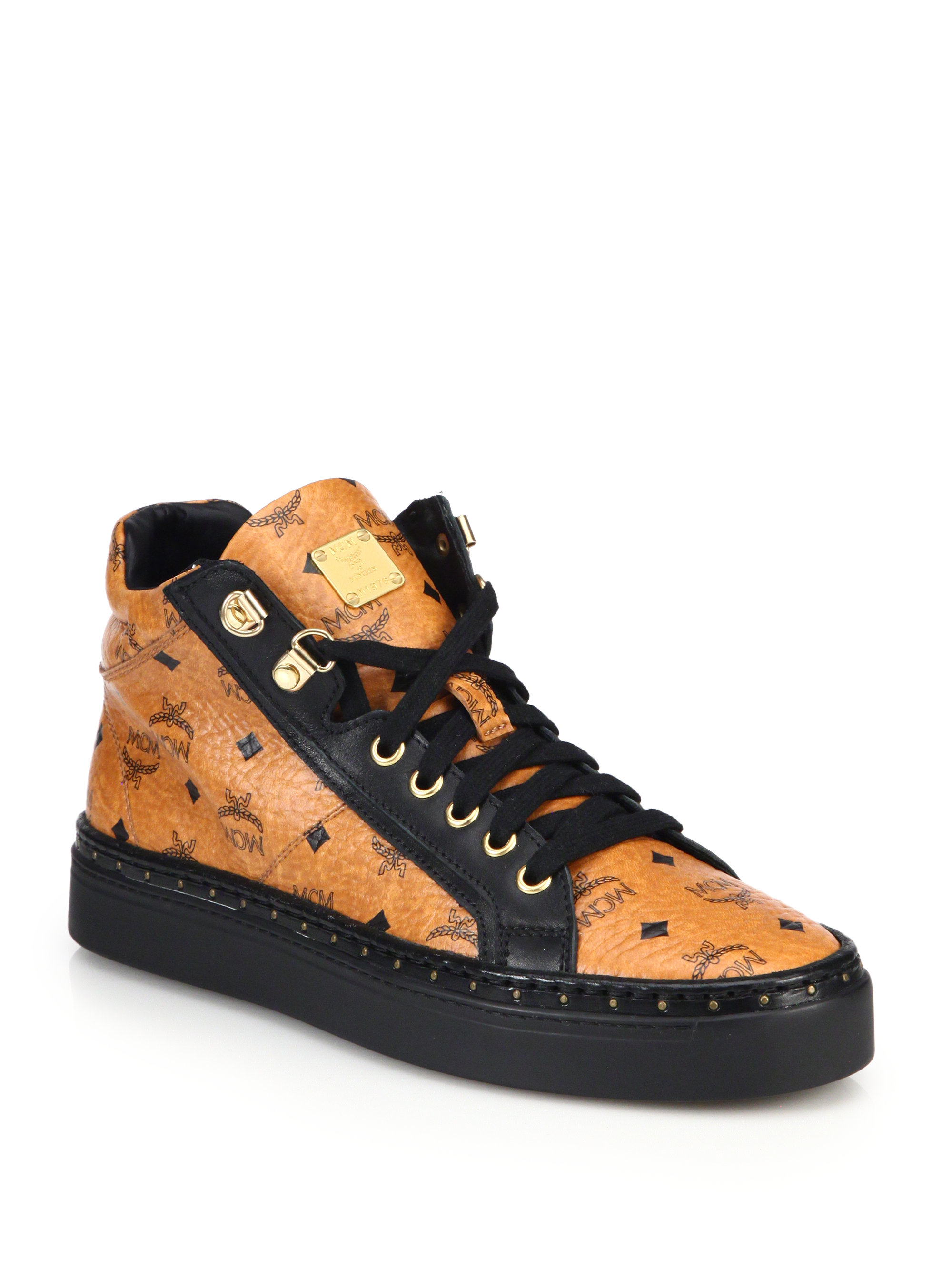 mcm coated canvas mid top sneakers in brown for lyst